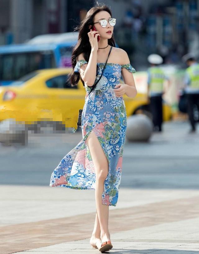 上海美女:身穿白色的蕾丝短裙,搭配出了青春的感觉
